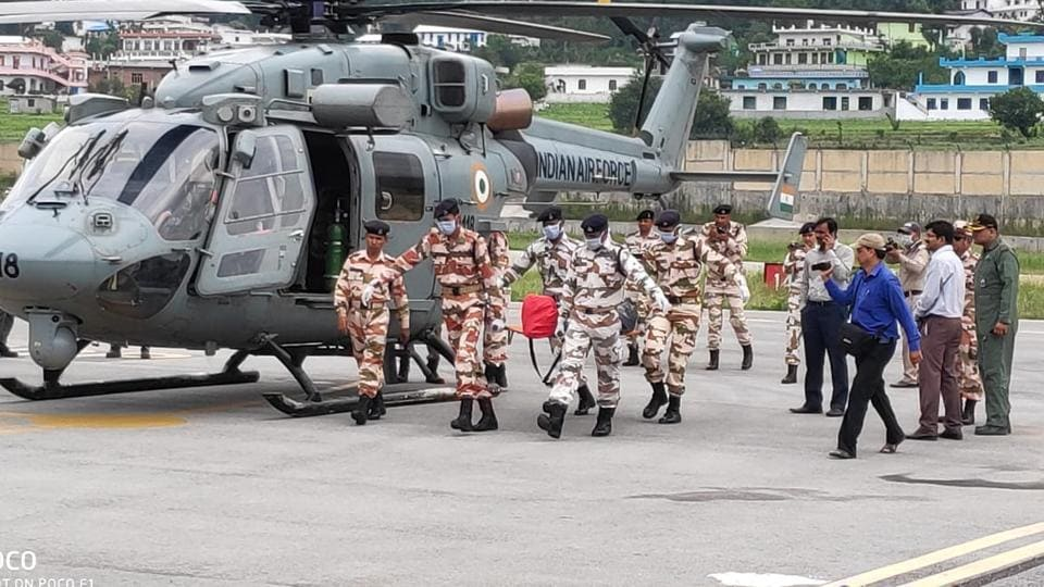 ITBP personnel carry the bodies of climbers at Naini Saini airport in Pithoragarh where they were brought down on Wednesday morning by IAF choppers.
