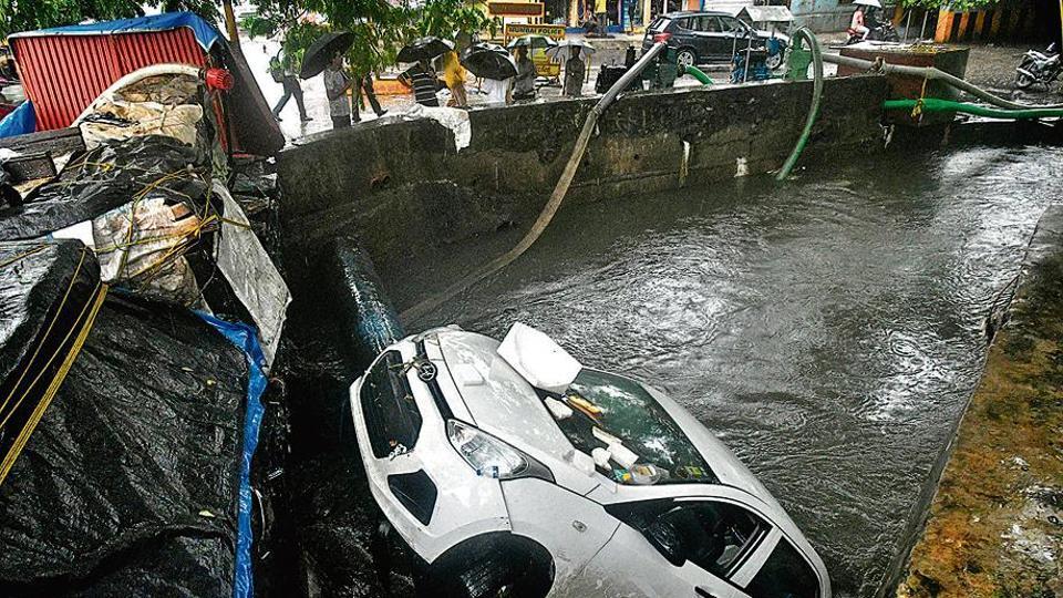 A car got washed away into a drainage near Andheri subway in Mumbai, India, on Tuesday, July 2, 2019. (Photo by Shashi S Kashyap/ HT PHOTO)