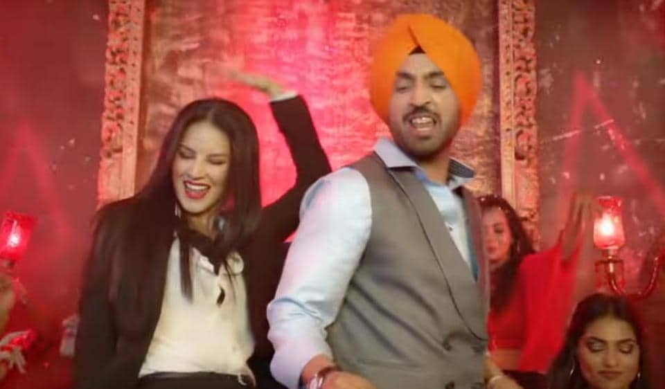 Sunny Leone and Diljit Dosanjh in a still from Arjun Patiala song, Crazy Habibi Vs Decent Munda.