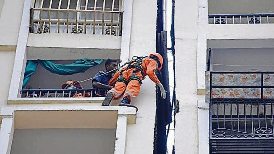 Members of the National Disaster Response Force (NDRF) during the operation to pull down the body of a woman who mysteriously stuck and died in one foot shaft between two towers of Amrapali Silicon City, Sector 76, in Noida.
