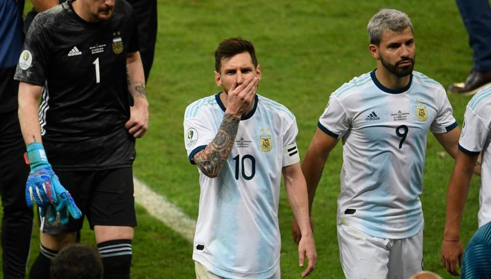 Argentina's Lionel Messi (C), Sergio Aguero (R) and goalkeeper Franco Armani (L) leave the field after losing 2-0 to Brazil in a Copa America football tournament semi-final match at the Mineirao Stadium in Belo Horizonte, Brazil, on July 2, 2019
