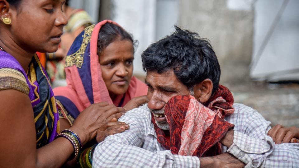 Relatives mourn the death of their deceased relatives at Sassoon hospital in Pune on Tuesday.