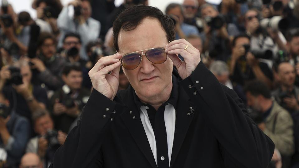 Director Quentin Tarantino poses for photographers at the photo call for the film Once Upon a Time in Hollywood at the 72nd international film festival.