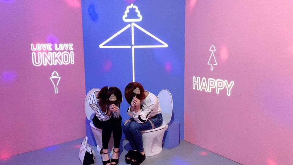 Visitors to the museum are asked to sit on one of seven colorful, non-functional toilets lined up against the wall.