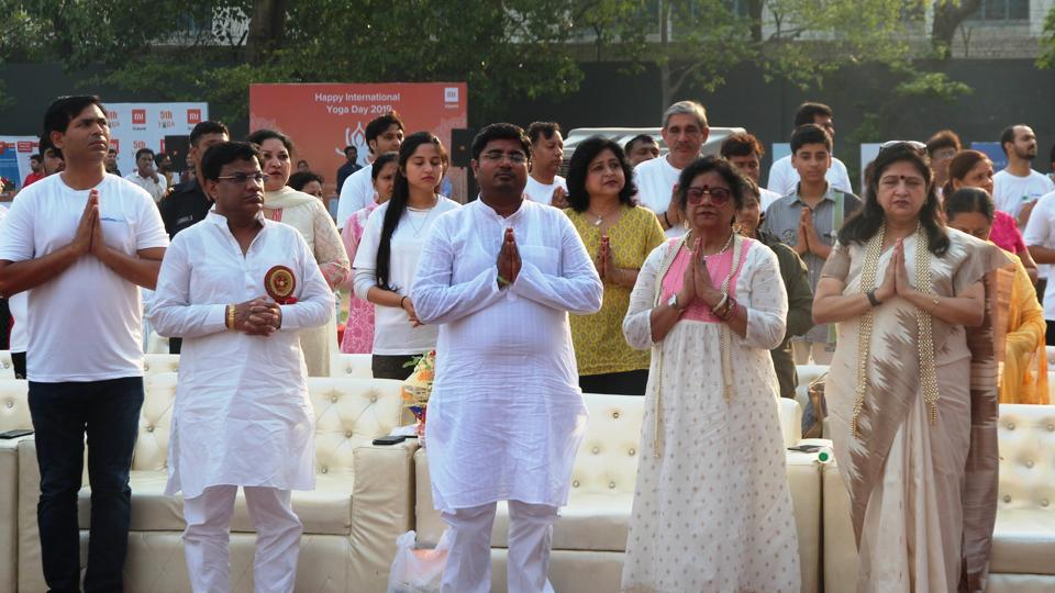 People  take part in the Yoga Day celebrations at Arwachin Bharti Bhawan Senior Secondary School, Vivek Vihar