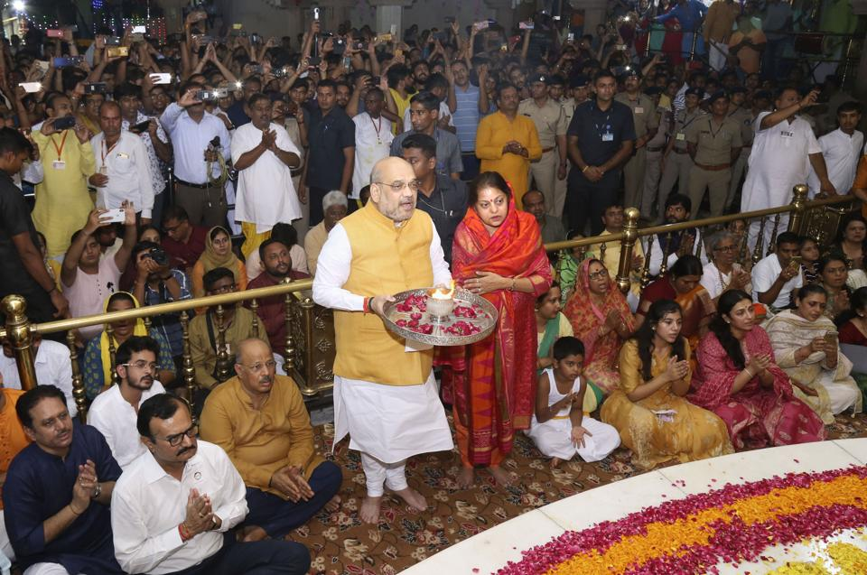 Union Home Minister Amit Shah, along with his wife Sonal Shah, performed the 'Mangala Aarti' on Thursday morning at the historic Jagannath Temple here, to kick-start the annual Gujarat Jagannath Rath Yatra that coincides with the Puri festival.