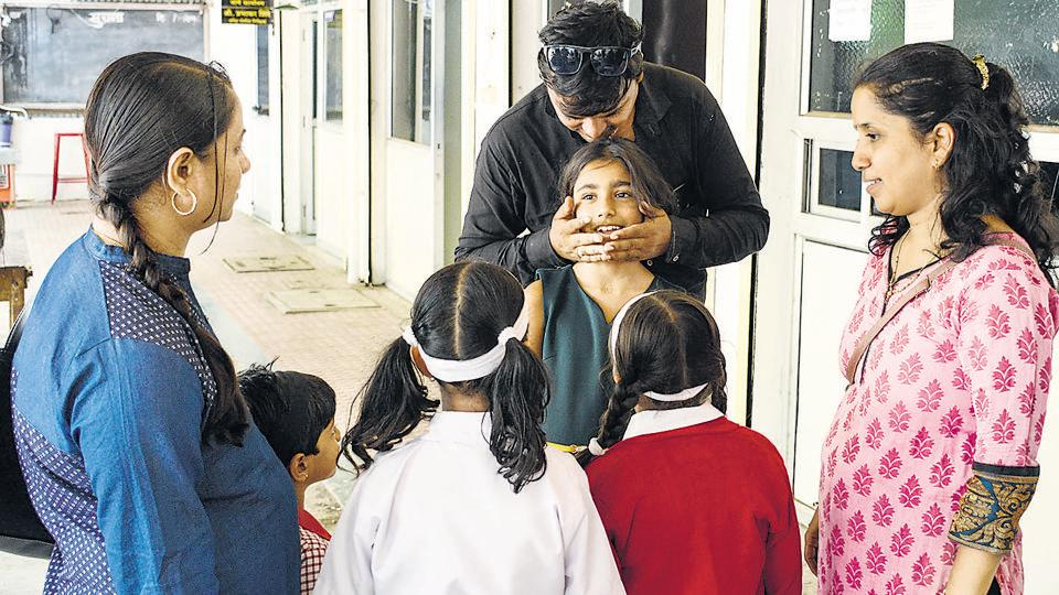 Jeevantika Tapase (second from right) with her neighbours and friends at the Sangvi police station on Wednesday.