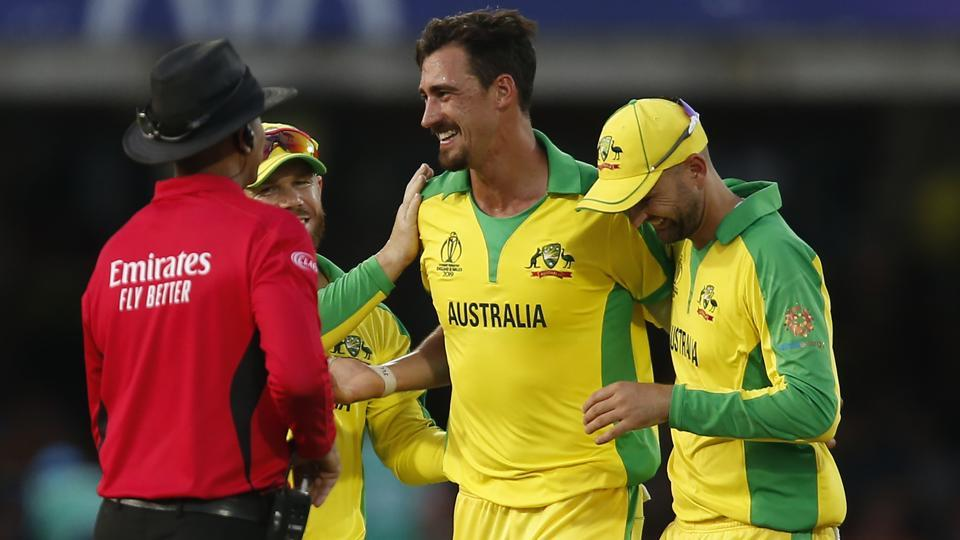 Australia's Mitchell Starc (C) celebrates with teammates after taking the wicket.