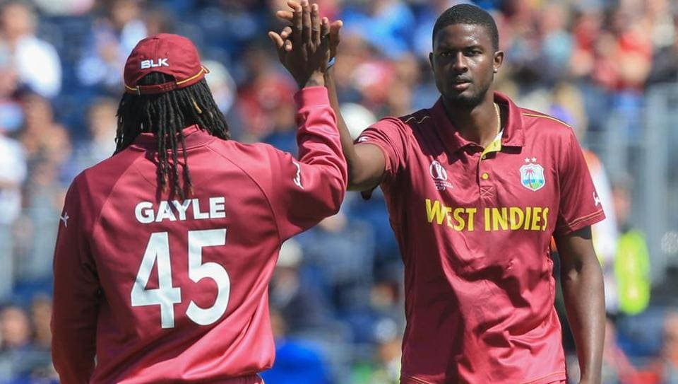 West Indies captain Jason Holder with Chris Gayle