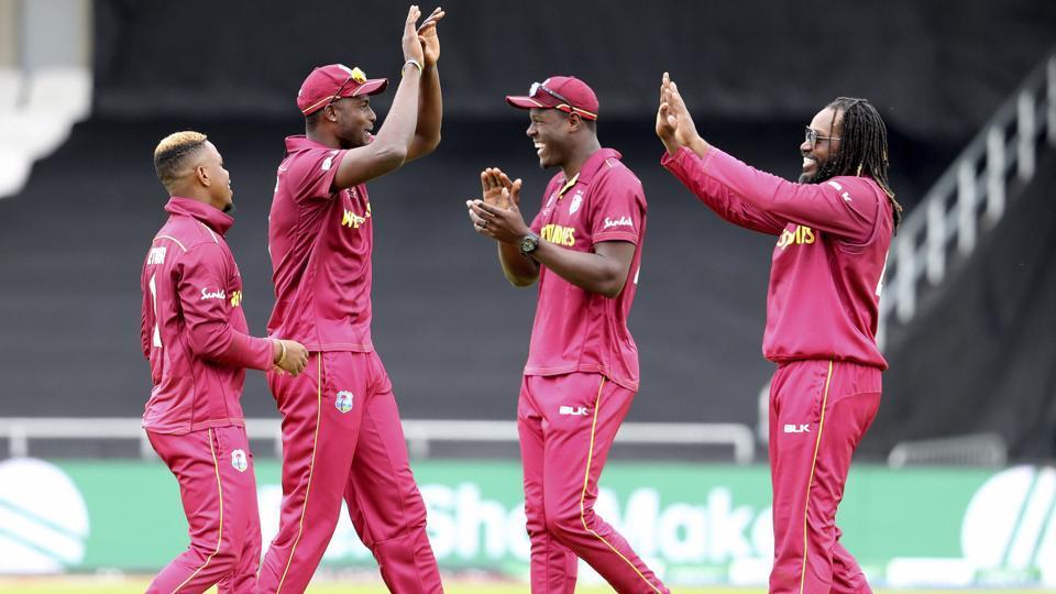 West Indies players celebrate the dismissal of Afghanistan's Najibullah Zadran (AP)