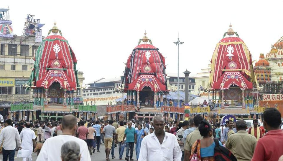 =evotees stand outside the Lord Jagannath temple ahead of the Rath Yatra in Puri on Wednesday. (ANI Photo)