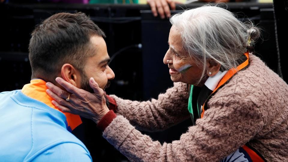 India's Virat Kohli meets fan, Charulata Patel, at the end of the match against Bangladesh