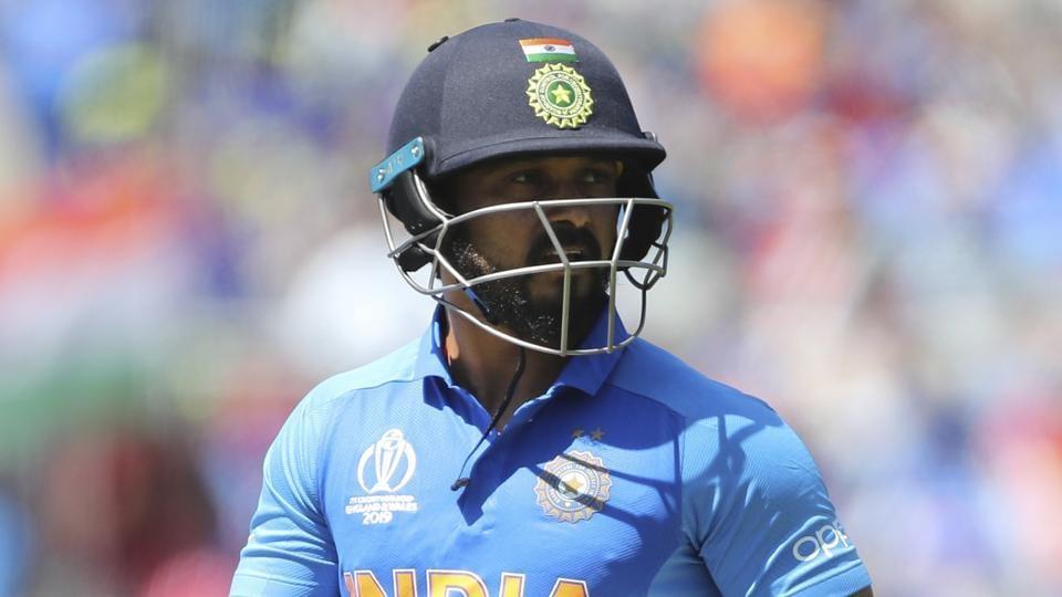 India's Kedar Jadhav leaves the field after being dismissed.