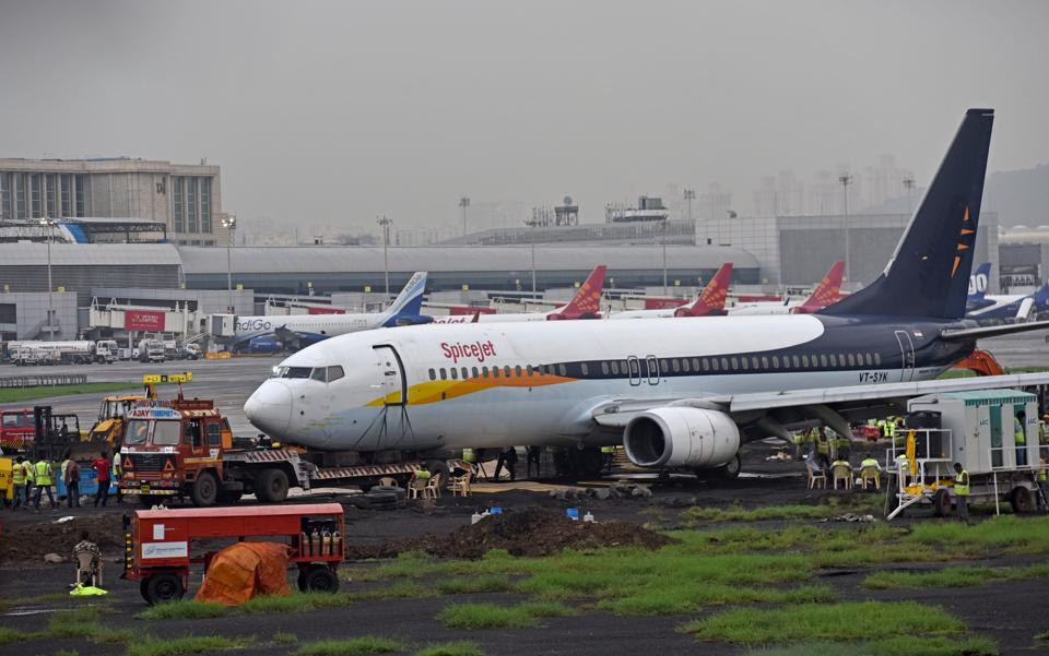 A team from Air India is heading the operations to tow away the SpiceJet aircraft which overshot the runway on Monday.