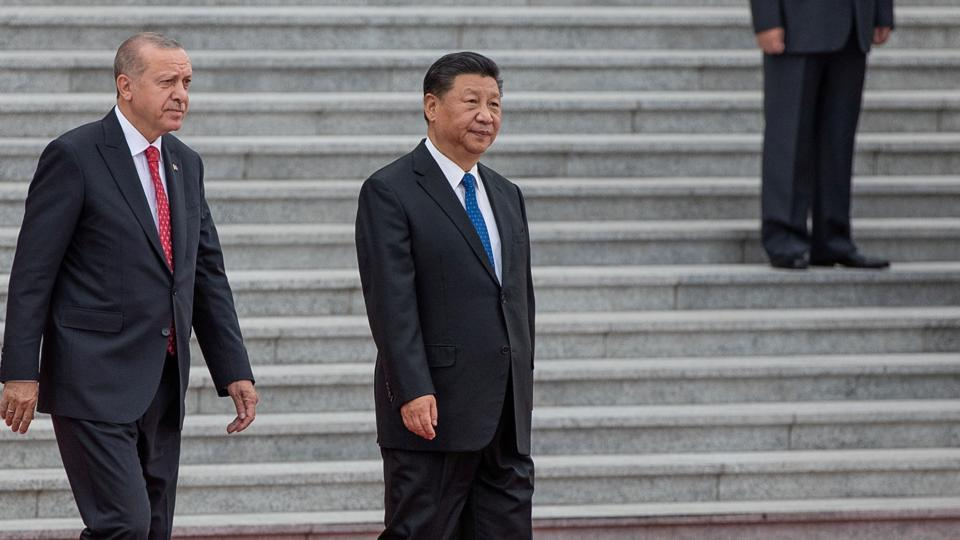 Turkish President Recep Tayyip Erdogan and China's President Xi Jinping attend a welcome ceremony at the Great Hall of the People in Beijing, China.