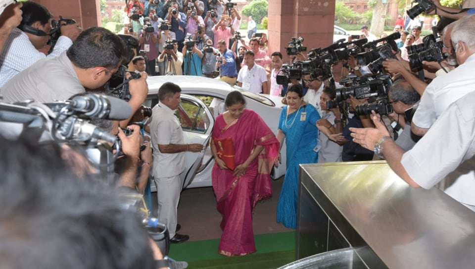 Union Finance Minister Nirmala Sitharaman  arrives at Parliament House to present the Union Budget in New Delhi on Friday.