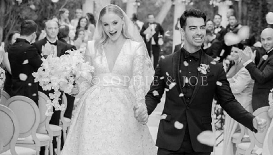 ​SophieTurner wore a custom Louis​ ​Vuitton bridal dress by​ ​NicolasGhesquiere at ​​her wedding​.​