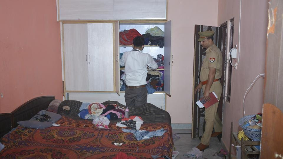 Police and forensics officials at the crime scene, at  in a Ghaziabad lcoality where a  man allegedly committed suicide after killing his wife and three children.