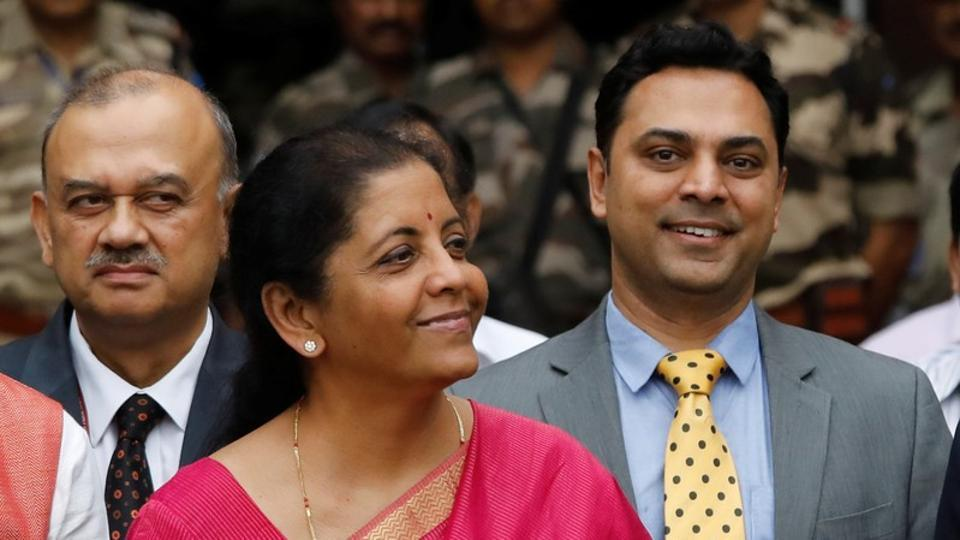 India's Finance Minister Nirmala Sitharaman (C) and Krishnamurthy Subramanian (R), chief economic adviser pose during a photo opportunity outside their office before the presentation of the federal budget in the parliament in New Delhi.