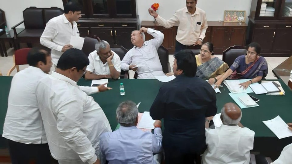 Eight Congress and three JD(S ) MLAs at the Assembly Speaker's  office on Saturday.