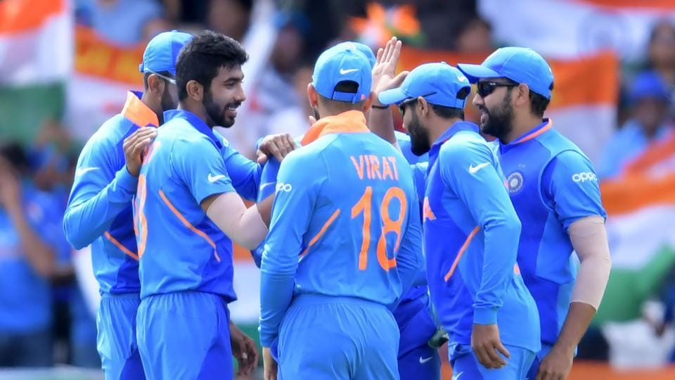 India's Jasprit Bumrah (2nd L) celebrates with teammates.
