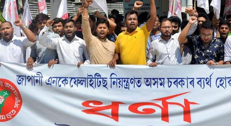 Activists of the All Assam Students' Union (AASU) stage a protest in Guwahati against the government over the deaths due to Japanese Encephalitis in the state.