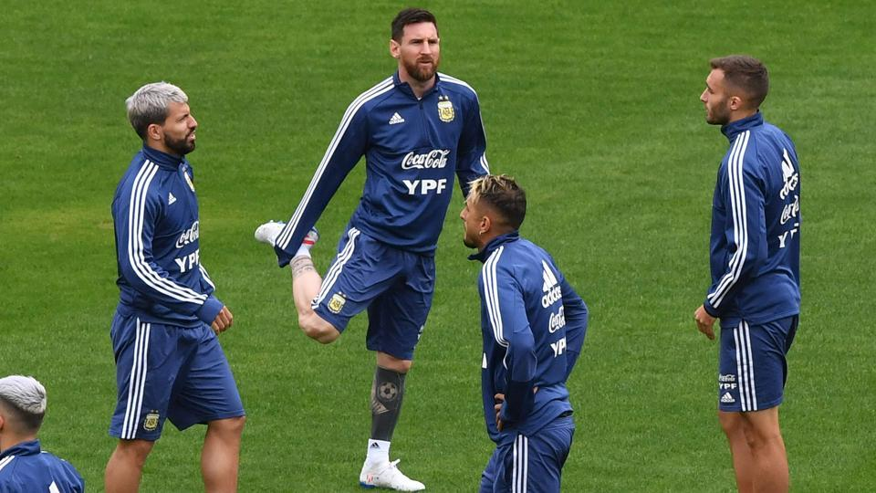 Argentina's player Lionel Messi (2-L) and Sergio Aguero (L) take part in a training session in Sao Paulo on the eve of the Copa America third place football match against Chile.