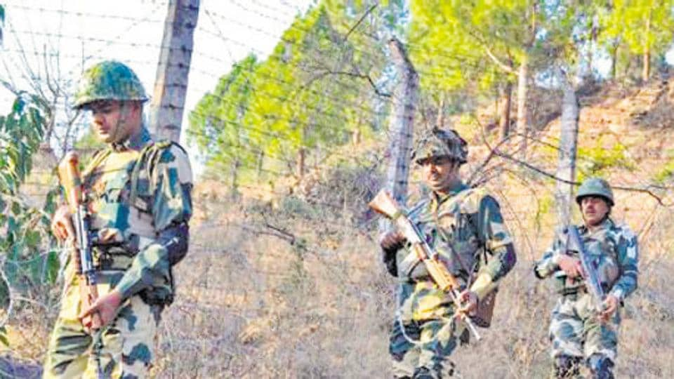 Poonch: Border Security Force (BSF) jawans patrol near Line of Control (LoC) . PTI Photo