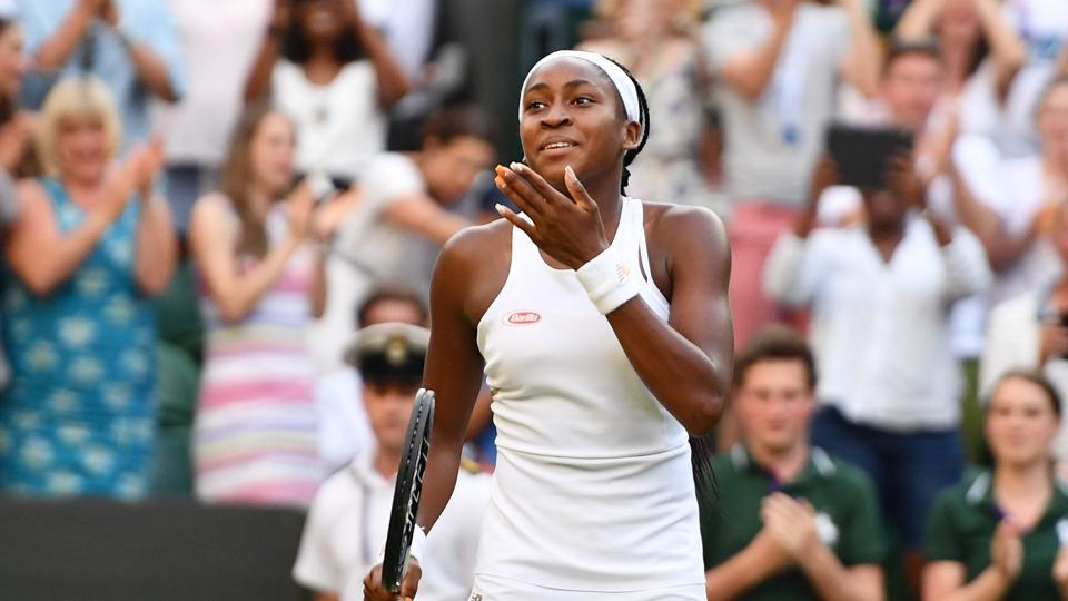 US player Cori Gauff celebrates beating Slovenia's Polona Hercog during their women's singles third round match at The All England Lawn Tennis Club in Wimbledon.