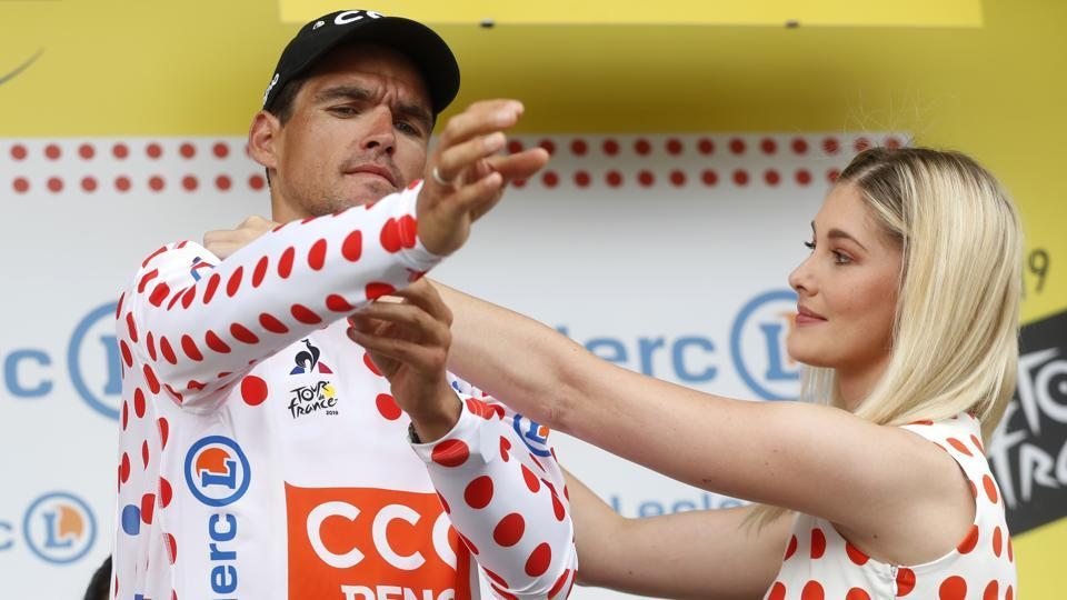 Belgium's Greg Van Avermaet puts on the best climber's dotted jersey after the first stage of the race with over 194.5 kilometers (120,86 miles) with start in Brussels and finish in Brussels. (Thibault Camus / AP)