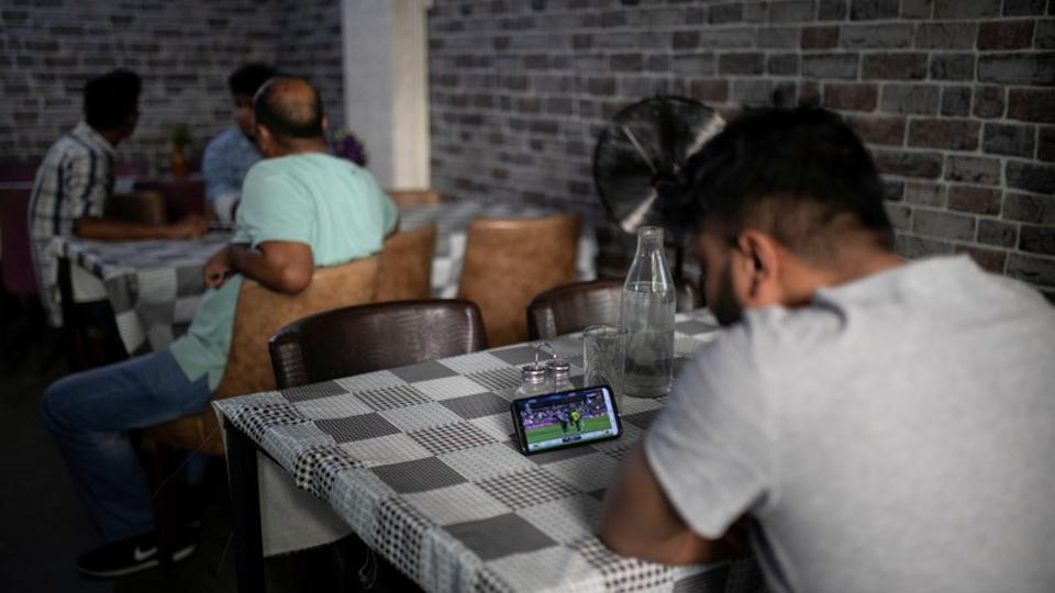 A man watches his national cricket team's World Cup game against South Africa in a restaurant in central Athens. In football loving Greece, cricket is an alien concept. But for its migrants from Pakistan, one of the world's most cricket-crazy nations, it is a way of life. (Alkis Konstantinidis / REUTERS)