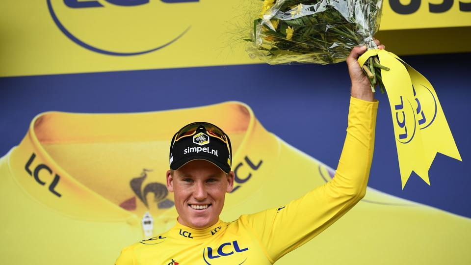 Dutch rider Mike Teunissen celebrates his overall leader's yellow jersey on the podium of the first stage of the 106th edition of the Tour de France cycling race. (Anne-Christine Poujoulat / AFP)