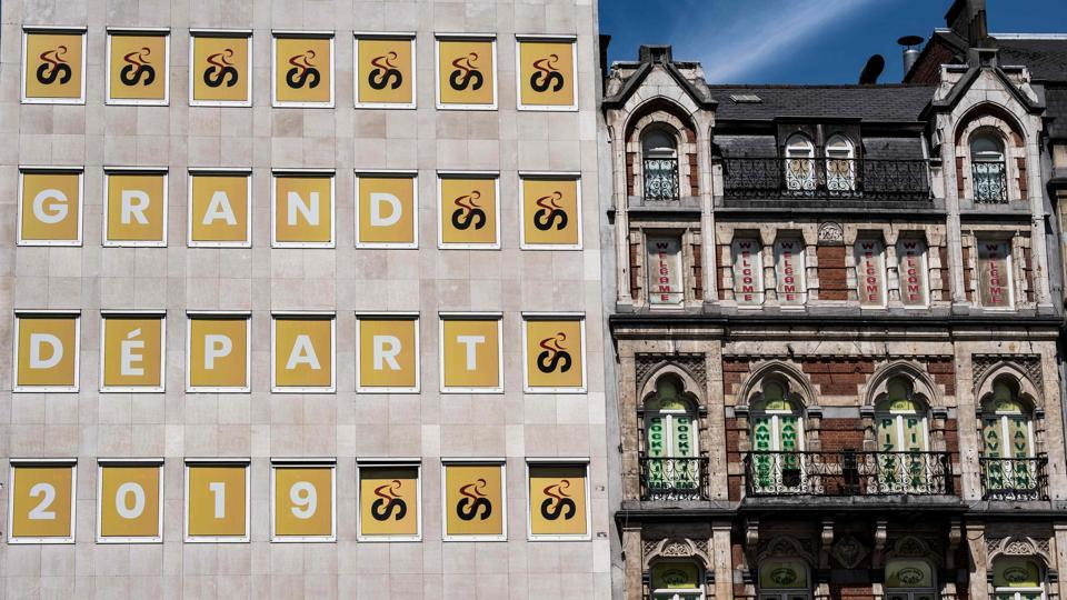 The windows of a building are decorated with the logo of Brussels Grand Depart 2019 in Brussels, three days prior to the start of the 106th edition of the Tour de France cycling race.  (Jeff Pachoud / AFP)