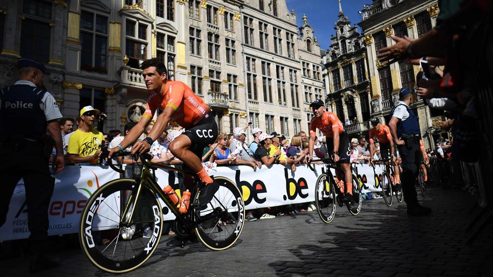 Belgium's rider Greg Van Avermaet (L) of Poland's CCC Team arrives with teammates for the team presentation ceremony at the Grand-Place - Grote Markt Square in Brussels two days prior to the start of the 106th edition of the Tour de France cycling race. (Anne-Christine Poujoulat / AFP)