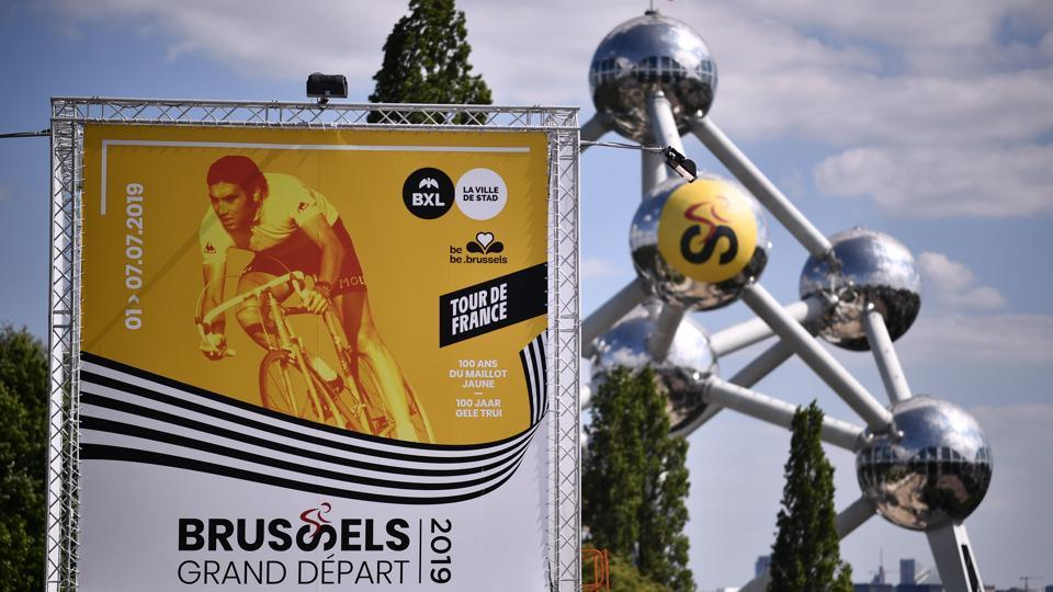 A view of a poster of Brussels Grand Depart 2019 with the Atomium in background in Brussels. (Marco Bertorello / AFP)