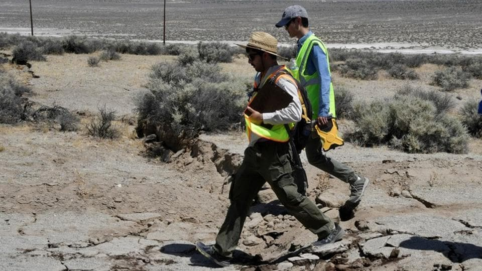 U.S. Geological Survey technicians examine cracks along State Route 178 after an earthquake near Ridgecrest, California, U.S. July 6, 2019. Image used for representational purpose only.