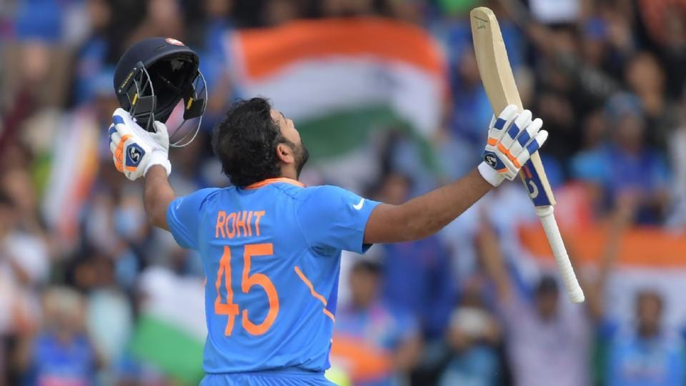 India's Rohit Sharma celebrates after reaching his century.