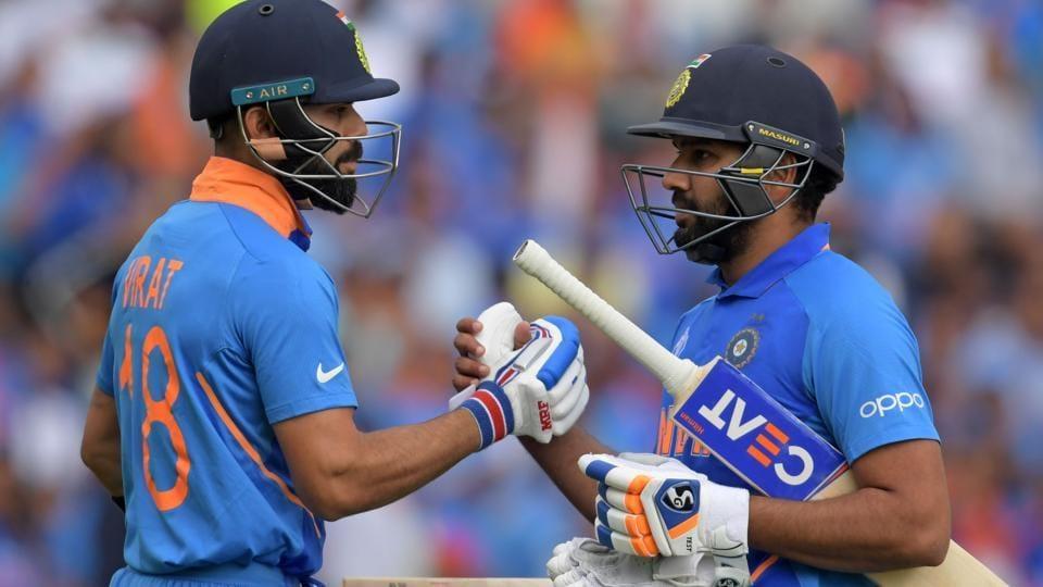 India's captain Virat Kohli (L) congratulates India's Rohit Sharma (R).