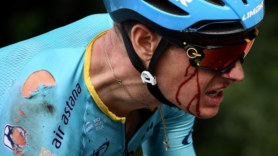 Astana Pro Team rider Jakob Fuglsang of Denmark bleeds as he rides after a crash with just 11 miles to go.  (Jeff Pachoud / REUTERS)