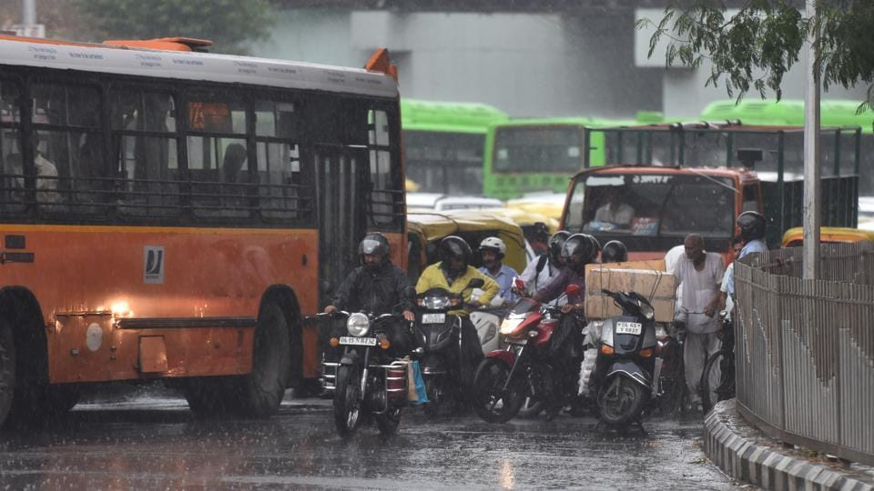 New Delhi, India - July 5, 2019: Traffic moves during the rain, at ITO, in New Delhi, India, on Friday, July 5, 2019.