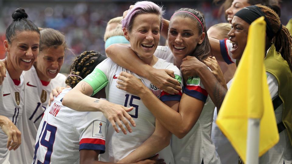 United States' Megan Rapinoe, center, celebrates after scoring the opening goal.