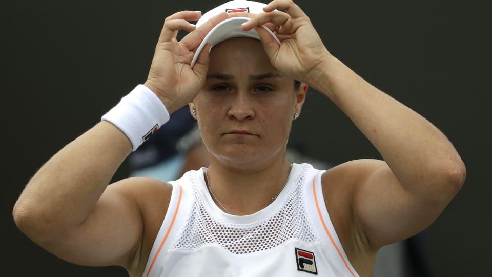 Australia's Ashleigh Barty adjusts her cap during a break in a women's singles match.