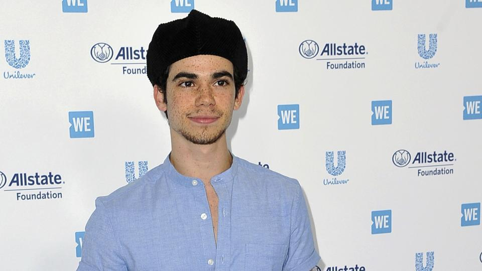 In this April 25, 2019, file photo, Cameron Boyce arrives at WE Day California at The Forum in Inglewood, Calif. Actor Cameron Boyce, known for his roles in the Disney Channel franchise Descendants and the Adam Sandler Grown Ups movies, died Saturday, July 6, 2019, at his home in Los Angeles, according to his spokesperson. He was 20.