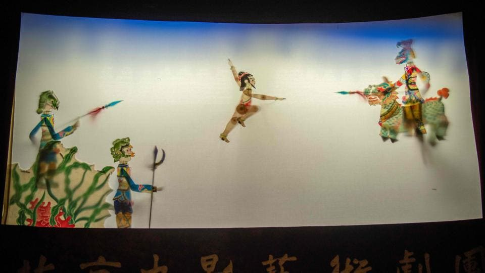 Puppets are seen on a shadow theatre stage during a performance by the Beijing Shadow Show Troupe at a school in Beijing.