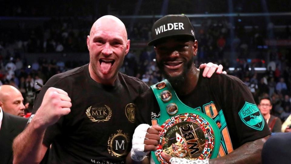 FILE PHOTO: Deontay Wilder and Tyson Fury after the fight for the WBC World Heavyweight Title at the Staples Centre, Los Angeles, United States.