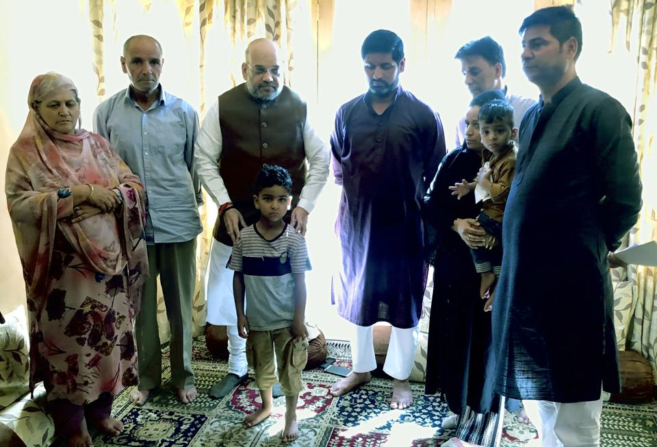 Union home minister Amit Shah meeting the family members of police officer Arshad Khan, who was killed in an encounter in Anantnag in June. His real test will be in the inclusiveness of the participation in the forthcoming assembly elections
