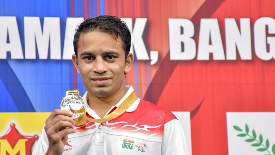 India's Amit Panghal poses for photos after securing a gold medal at Asian Wrestling Championships 2019 in Bangkok, Thailand.
