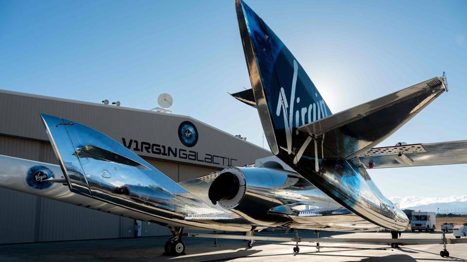In this file photo taken on February 22, 2019 courtesy of Virgin Galactic, SpaceShipTwo mates to the mothership, WhiteKnightTwo, at Mojave Space Port on February 19, 2019, in Mojave, California.