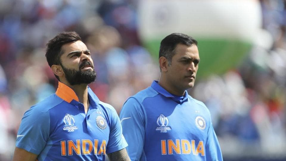 Indian captain Virat Kohli with MS Dhoni standing for national anthem at the Cricket World Cup in London.