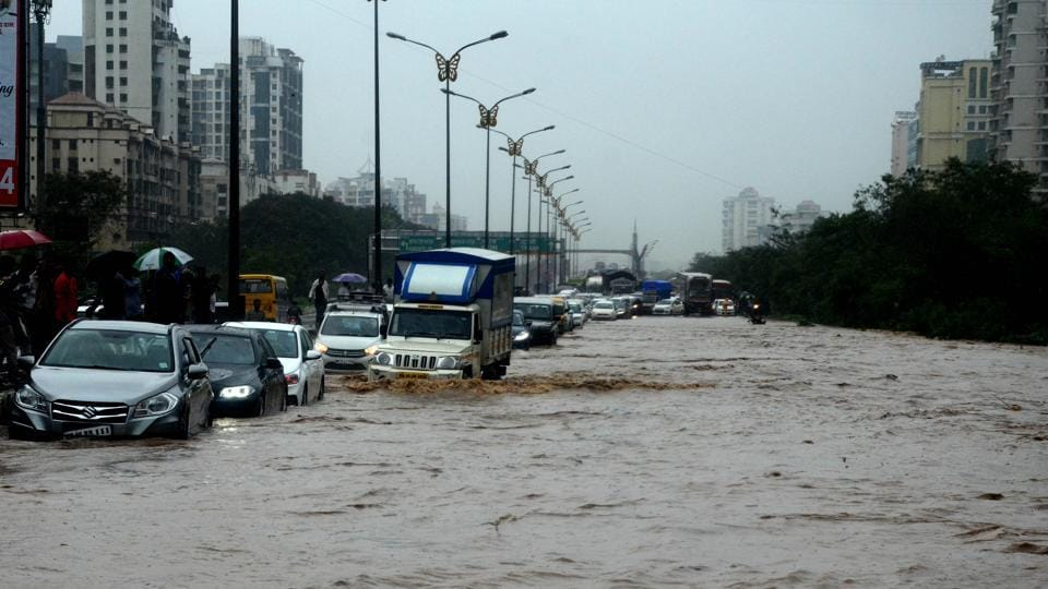 """On Tuesday, a couple was washed away while crossing a bridge on a bike above Gadi river at Panvel. The incident took place at Umroli village along Matheran road, around 15 kilometers from Panvel city around 7.30 am. As the couple was crossing the bridge, the water level of the river increased all of a sudden and the strong current washed away the couple with the bike,"""" said a police officer from Panvel taluka police station. (Bachchan Kumar / HT File)"""
